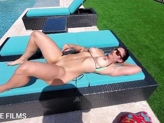 'Fit milf sun tans outside in skimpy bikini, then strips, and makes herself cum. Neighbor close by'