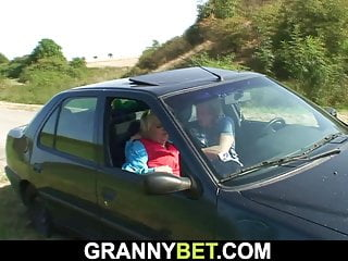 Very old blonde grandma gives head in the car