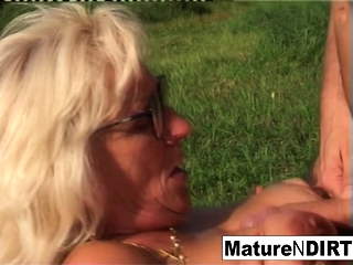 Light-haired grannie gets some spunk on her glasses