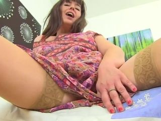 Mature brunette took off her dress and panties and showed her hairy pussy to the camera