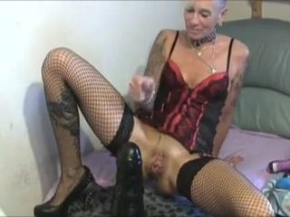 Filthy granny rides goant black dildo alone