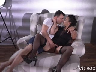 Mother big-boobed super-sexy French cougar in ebony tights underwear and high high-heeled shoes