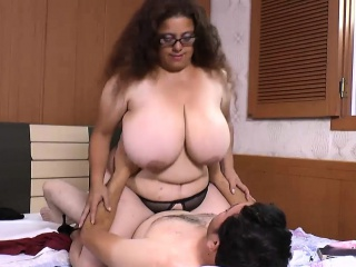 Brunette with huge tits is getting fucked by man