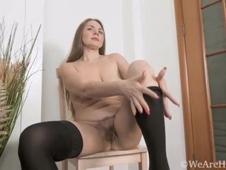Bossaia Golloia strips naked on her wooden chair - WeAreHairy
