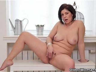 Euro milf Nicol rubs the brush neatly trimmed pussy