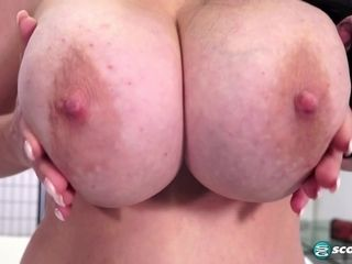 Supah chesty brown-haired mommy plays with her fat naturals in striptease sesh