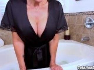 """Catalina Cruz massages her large breasts in a hot bath masturbating"""