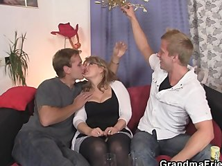 Mature babe in stockings takes two cocks