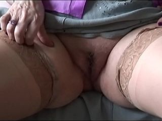 Mature grandma with phat knockers and furry pubic hair disrobing and taunting