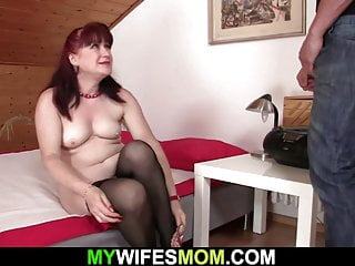Mommy toying with XXL fake penis before railing