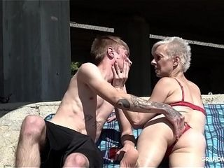 Bony trapper eats short-hair grandma under the bridge