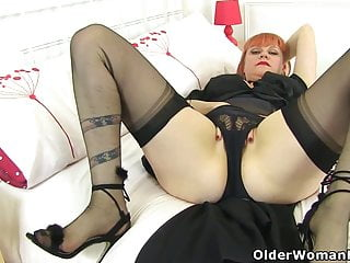 UK ginger-haired cougar Velvetina playthings her fur covered and raw fanny