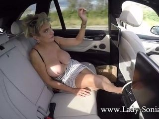 'Big boob mature Lady Sonia exposes her tits in the car'