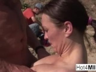 """""""Busty MILF with natural tits fucks on the beach"""""""
