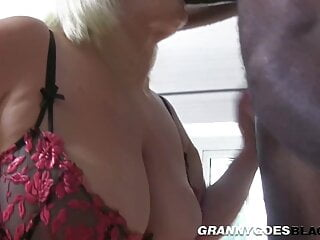 Gran takes long black dong in her mouth