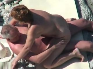 Mature naturist duo caught pummeling at the beach