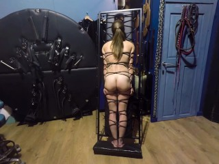 Cute butt on show as K is strapped to the bondage board