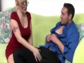 Cougar in spex tugs salami for fortunate boy and wants his jizz