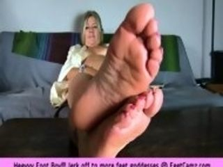 Lovely grannie with glasses resting her beautiful soles and toes