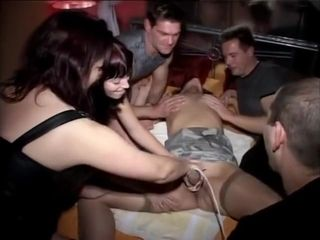 report in a swinger's club with a beautiful slut submissive
