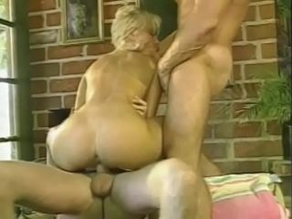 Slim light-haired gets her slots crammed with 2 penises