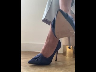 Business woman in high heels ignores you as you lay on the floor watching
