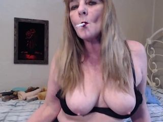 Sultry Topless Smoking In Leather Gloves - TacAmateurs