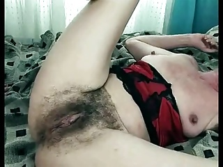 Hairy mature with visible clit provokes