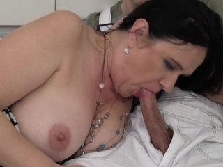 Busty mature MILF in hardcore action in the kitchen with cumshot
