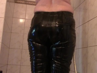 Moist vinyl pants (Showering in cuffs and gas mask)