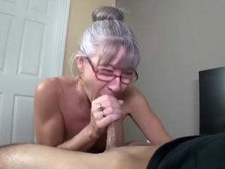 Mature with lil' udders receives facial cumshot