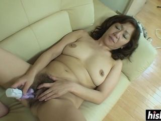 Chinese GILF gets her furry labia pounded