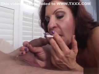 Smoking grandma flashes her throating abilities