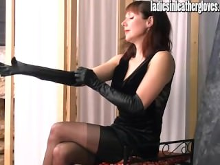 Hot posh Milf gets sexual after putting on her tight black leather gloves