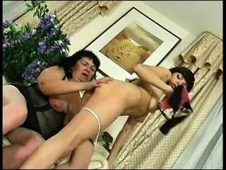 Mature widow sucking strapon while fucked with other strapon