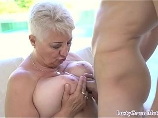 Buxomy gilf entices youthfull stud into wild romp