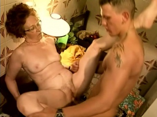 Eager grandma spreads her legs to have her wet cooch stretched