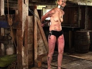 mature slave in flogging.