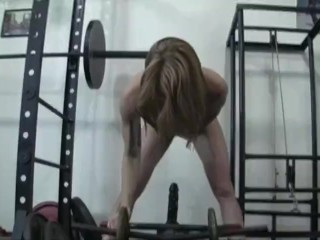 Robust womanlike Redhead Fucks Dildo round Gym