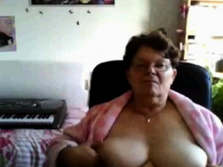 Insatiable grannie displaying her monstrous mounds on webcam