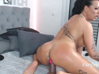 Buxom tattooed mommy fucks herself with a dildo