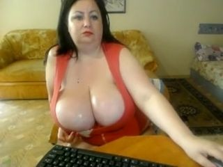 Plump cougar with immense sweat-soaked melons