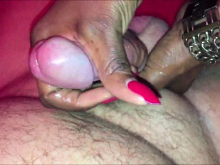Ebony mama stroking a white shaft to orgasm