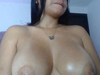 Big tits brunette sucks dildo webcam