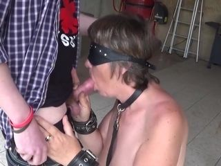 Old woman subdued and humiliated by a friend